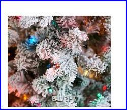 Bethlehem Lights 6.5' Slim Flocked Spruce Tree with Multi Color Lights