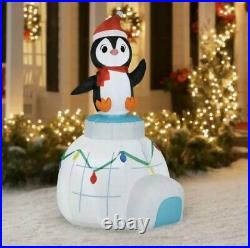 Holiday Time 5.5ft Animated Spinning Penguin on Igloo Scene Airblown Inflatable