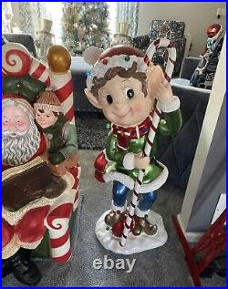 Kringle express elf with candy cane
